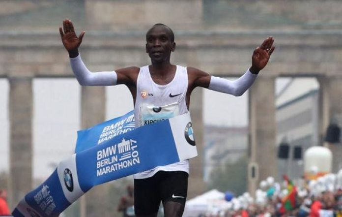 Athletics: Kipchoge misses record in rainy Berlin triumph