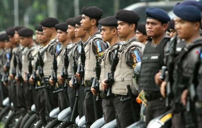Six police wounded, one killed in shootings near Indonesia's Freeport mine