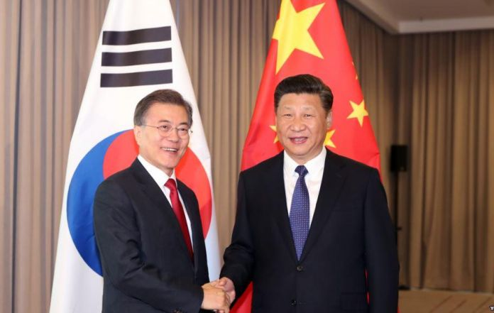 Moon, Xi Agree to Normalize Ties After THAAD Spat